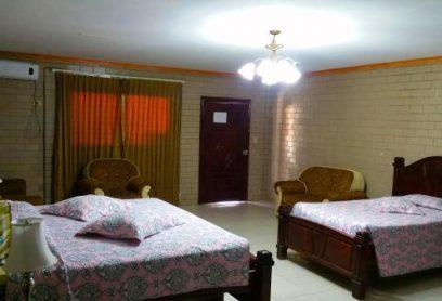 Habitación de 1 Cama King y 2 Camas 3/4 (Tipo Suite)